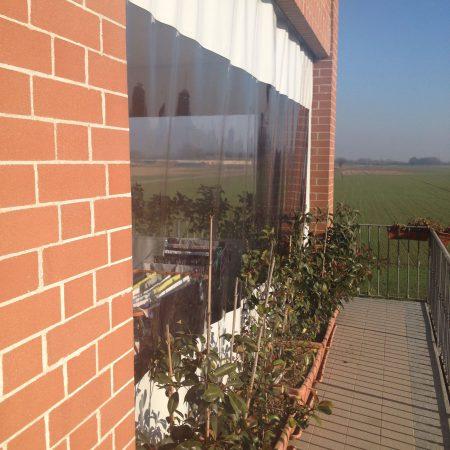 Chiusura scorrevole per terrazzo in PVC con fascia in Cristal trasparente - Venturello