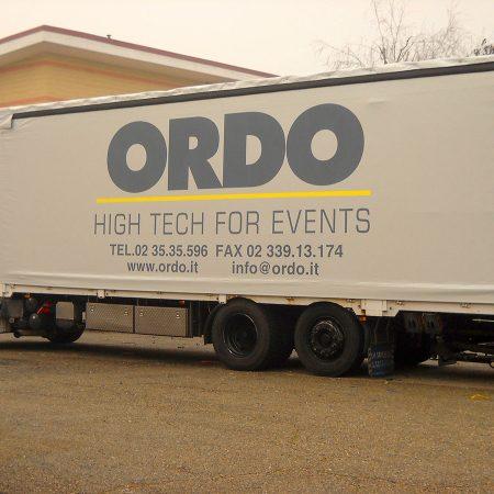 ORDO - Telone per camion centinato con laterali scorrevoli, rinforzi sul tetto e personalizzazione in vernice vinilica - Venturello
