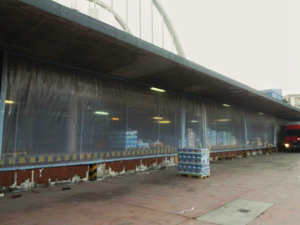 Teloni in PVC trasparente retinato per chiusura deposito Centrale del Latte Torino